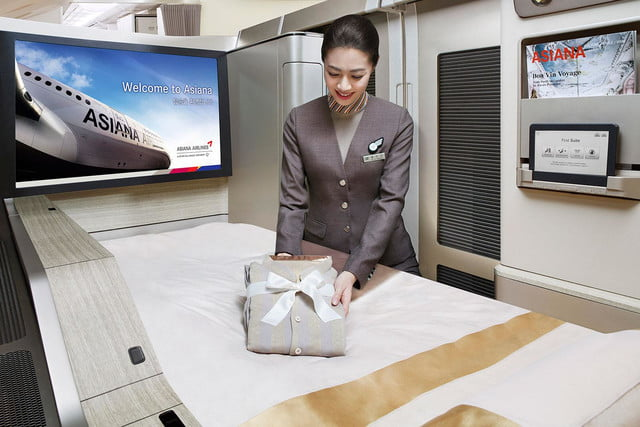 best first class airlines seats asiana suite duvet service