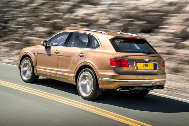 bentley says its bentayga suv can do it all but will customers bite  on road rear three quarter tracking 2