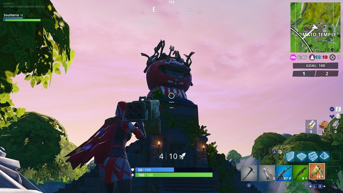 Fortnite Season 7 week 5 challenges search between a giant rock man crowned tomato and encircled tree