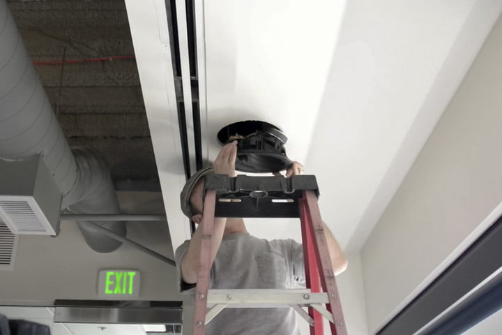 Inserting into ceiling | Install Dolby Atmos ceiling speakers