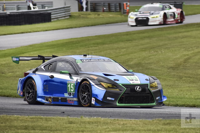Side shot of the Lexus RC F GT3 on the track with another car in the background