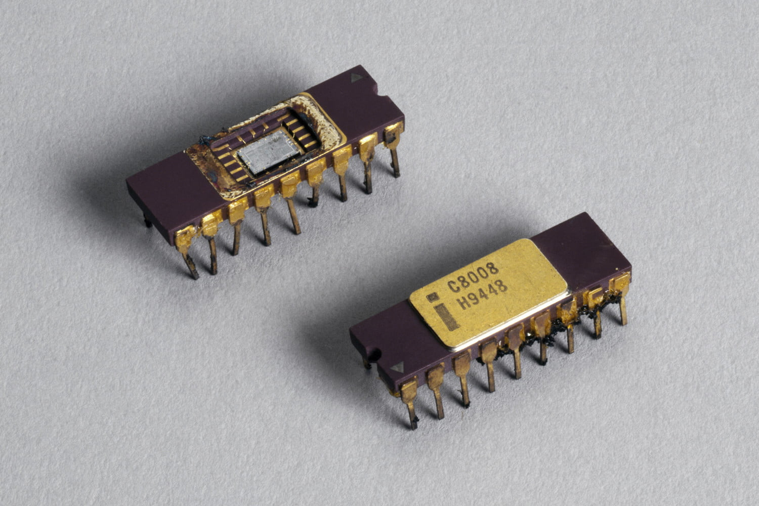 7 Reasons The End Of Moores Law Isnt Good Computers Inside A Typical Microchip You Can See Integrated Circuit And Two Intel 8080 Microprocessor Chips 1970s